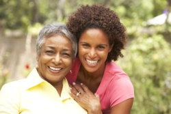 caregiver giving tea to elderly